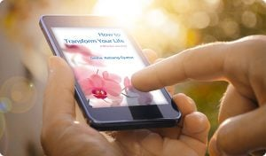 How to Transform Your Life being read on a mobiles phone