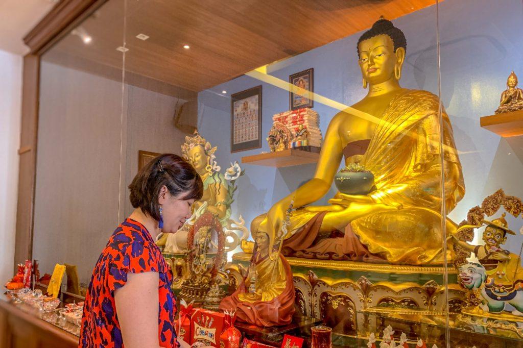 Buddha statue and woman Singapore