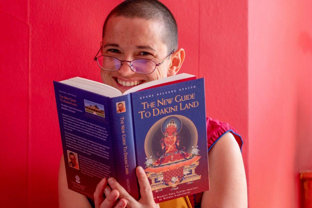 Nun-smiling-reading-NGTDL