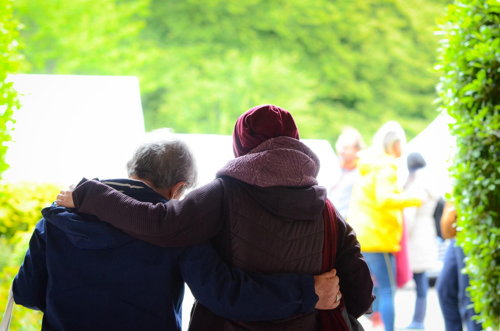 Peoples backs hugging Manjushri
