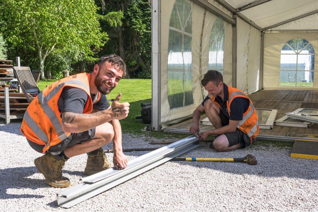 Volunteers erecting Marquee