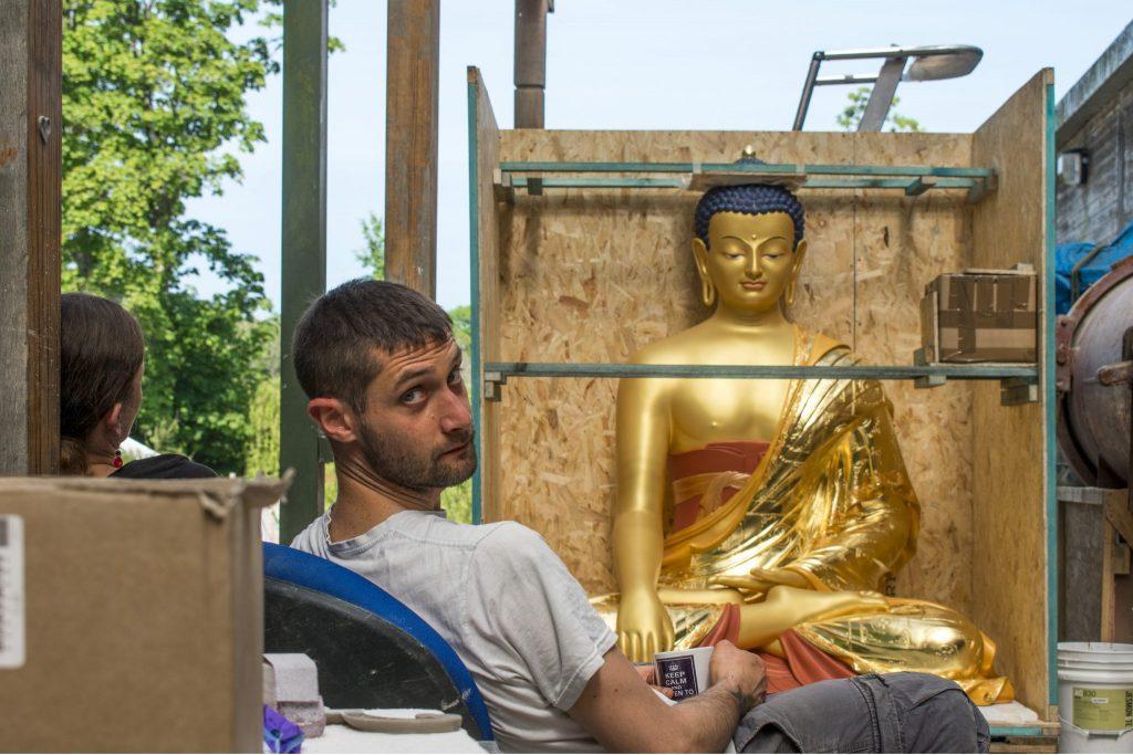 Volunteer crating Buddha