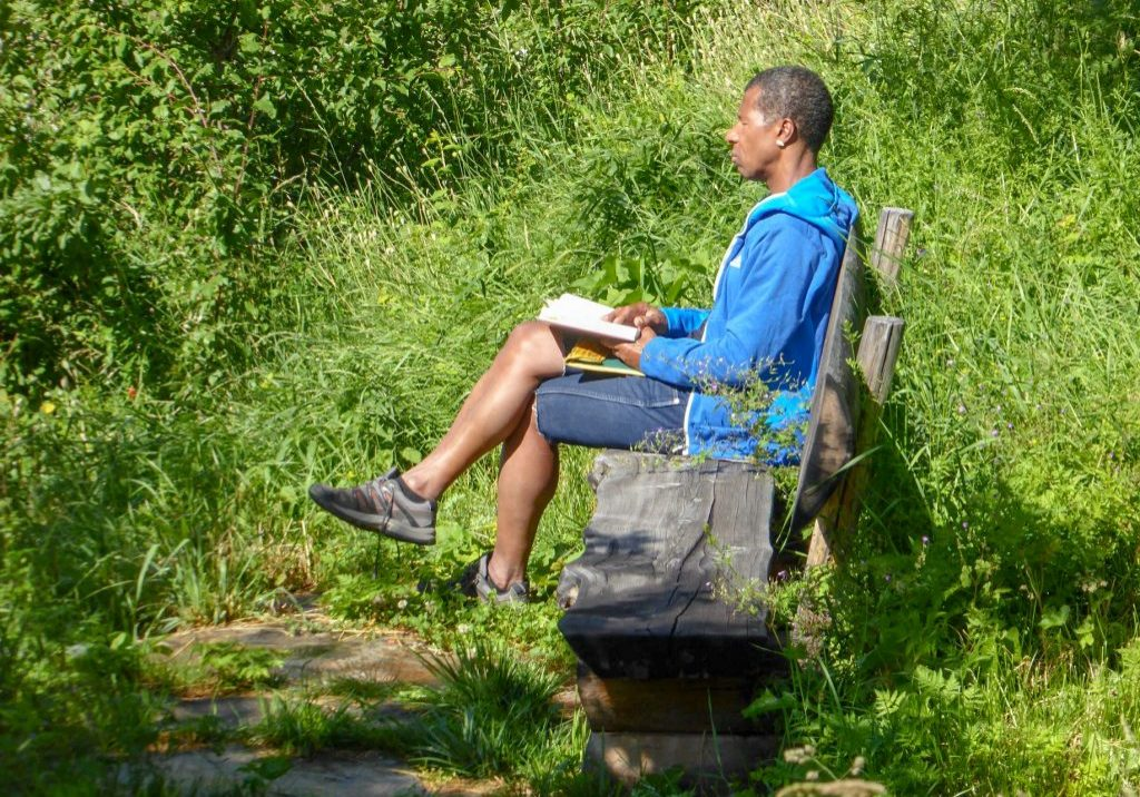 Man-reading-on-bench-Switzerland